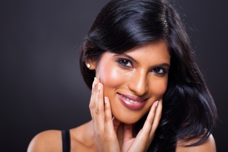 woman black background: close up portrait of beautiful indian woman on black background