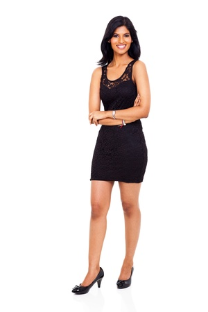 full length of smiling young indian businesswoman arms folded photo