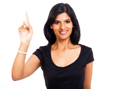 close up portrait of happy indian woman pointing up against white background photo