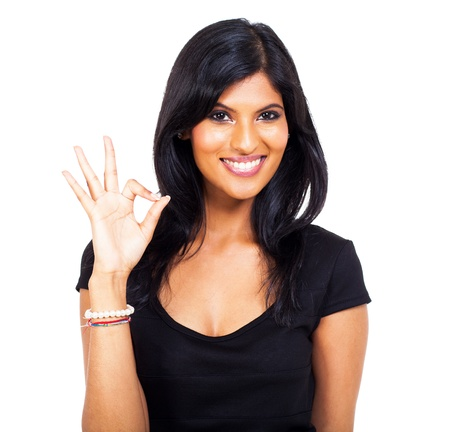 cheerful indian woman giving ok hand sign on white background Stock Photo