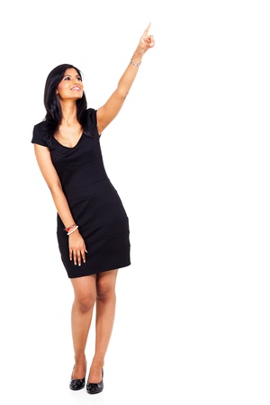 woman pointing: full length of young indian woman pointing up isolated on white background