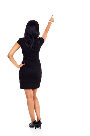 back up: back view of businesswoman pointing up isolated on white Stock Photo