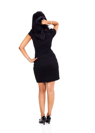 rear view of black haired businesswoman thinking  photo