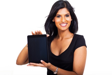 smiling young businesswoman showing tablet computer on white background photo