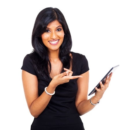 funny and cute young indian woman pointing tablet computer on white background photo