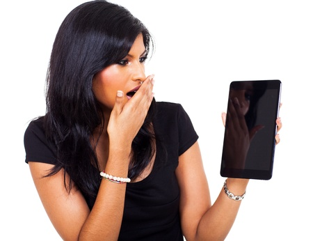 beautiful surprised businesswoman holding tablet computer  photo