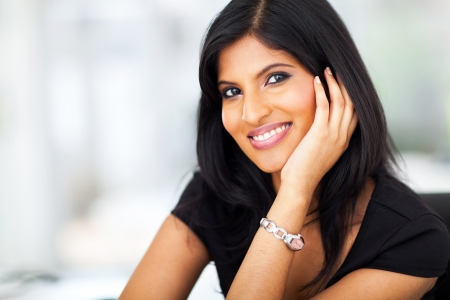 beautiful female indian white collar worker in office photo