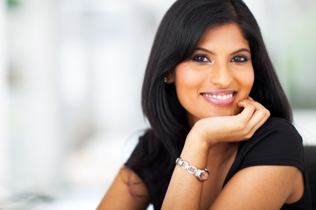 hair black: close up portrait of indian smiling businesswoman in office