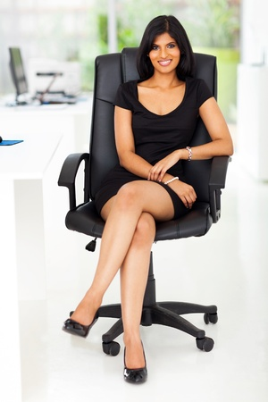 portrait of beautiful businesswoman sitting in modern office photo