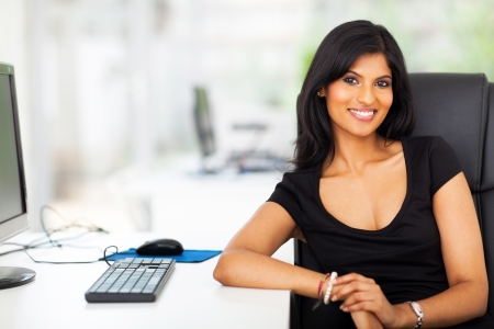 attractive female business executive in modern office photo