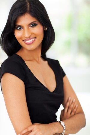 adult indian: portrait of young pretty indian businesswoman in office Stock Photo