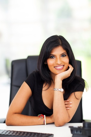gorgeous businesswoman: beautiful smart indian career woman in office Stock Photo