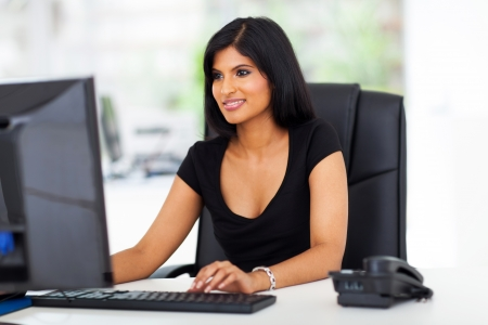 beautiful young hispanic businesswoman working in office Stock Photo