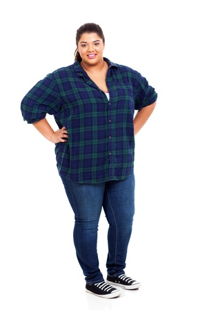 happy lovely large woman standing over white background photo