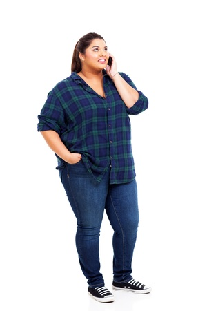 young plus size woman talking on cell phone and looking up