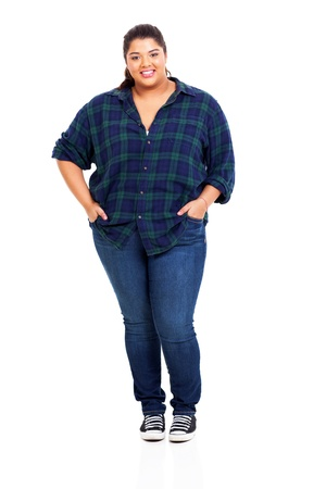 beautiful large woman in jeans isolated on white background Stock Photo
