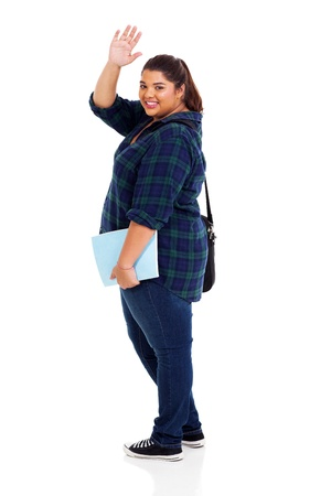 overweight students: full length of cheerful overweight student waving goodbye isolated on white background Stock Photo