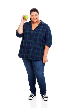 figure out: full length of smiling overweight woman holding green apple on white background Stock Photo