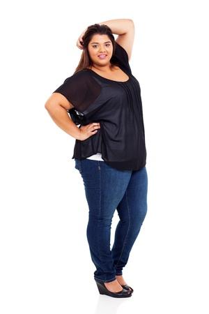 mujer gorda: amplia y encantadora chica retrato de cuerpo entero adolescente en blanco Foto de archivo