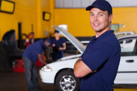 auto service business owner portrait inside workshop photo