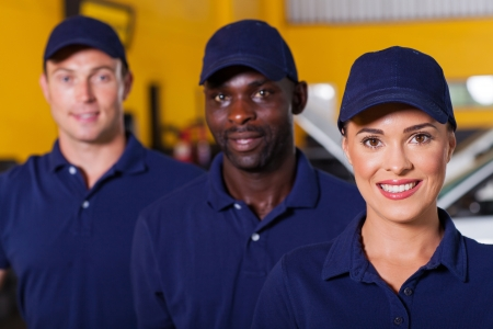 automobile workshop: group of auto repair shop employees