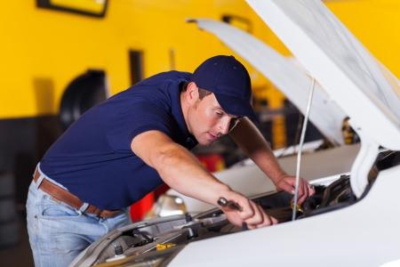 auto mechanic repairing vehicle inside workshop Stock Photo - 19202492