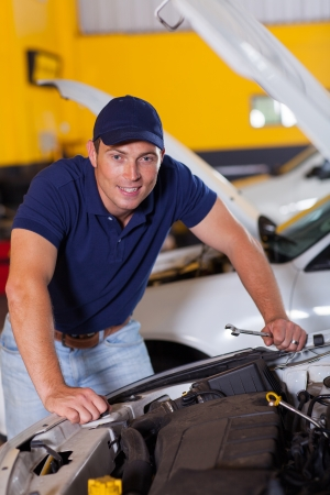 happy auto mechanic at work inside garage Stock Photo - 19202476