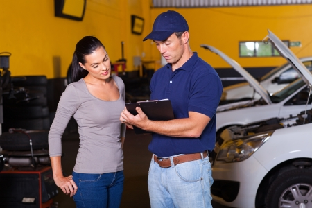 auto mechanic and young woman customer in workshop Stock Photo - 19202533