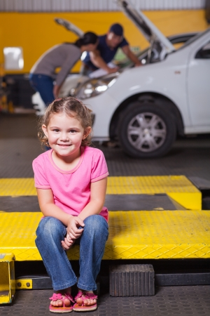 cute daughter waiting for mother in garage photo