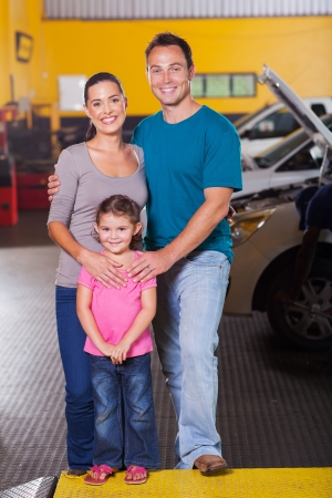 happy family inside car service center photo