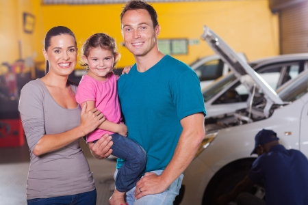 young family waiting in garage while their car serviced photo