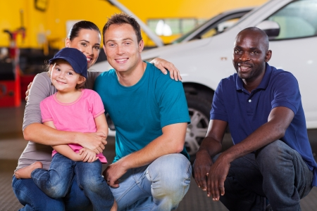 fun little girl wearing mechanic's cap in vehicle repair shop photo