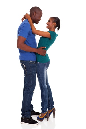 happy young african couple hugging on white background photo