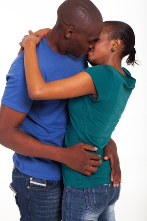 african american married couple kissing on white background photo