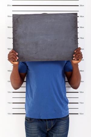 funny african man police mug shot photo