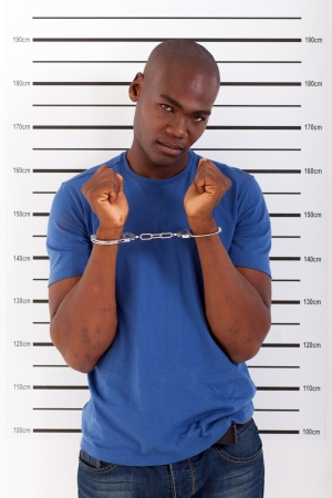 suspect: african american man got caught and arrested Stock Photo
