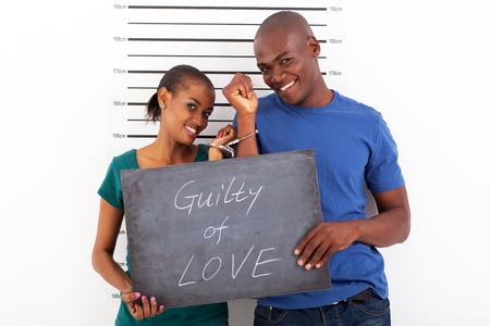 fun african young couple guilty of love photo