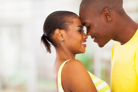 close up portrait of young african american couple flirting photo