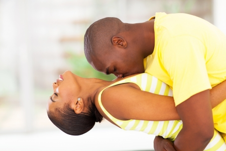 passionate kissing: passionate young african couple kissing