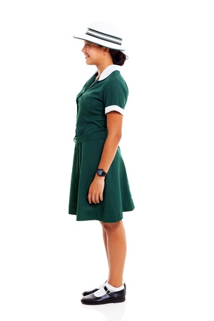 schoolgirl uniform: side view of a young teenage schoolgirl isolated on white background