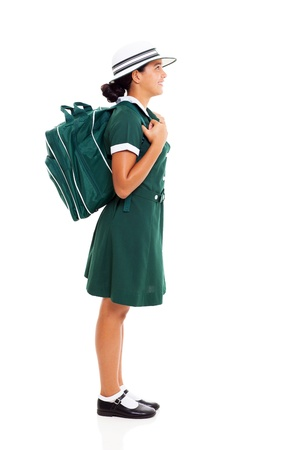 side view of young teenage school girl carrying her school backpack looking up photo