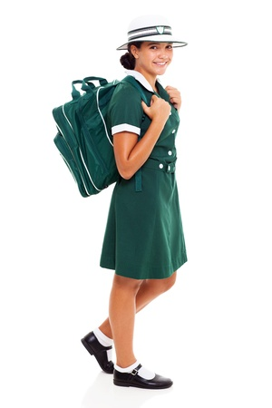 happy teenage girl carrying school bag going to school photo