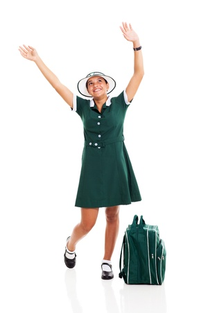 pretty schoolgirl raising her hands and looking up on white background photo