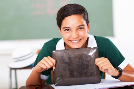 happy high school girl holding tablet computer photo