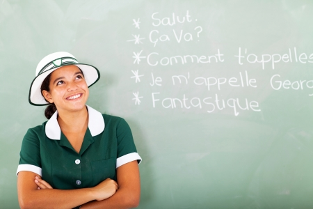 cheerful female high school student learning french in classroom photo