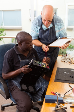 two senior men assembly electronic equipment in workshop  photo