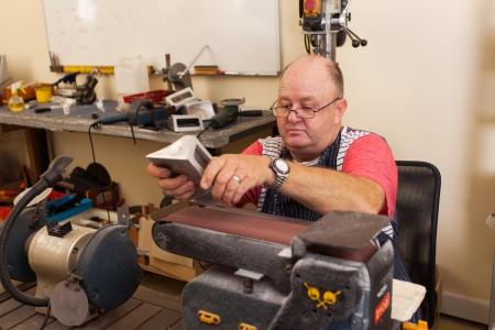 senior machinist working in workshop photo