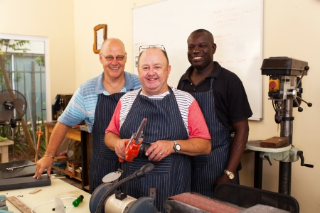 group of senior workers in workshop photo
