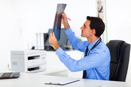 male doctor analyzing CT scane in office Stock Photo - 19410912
