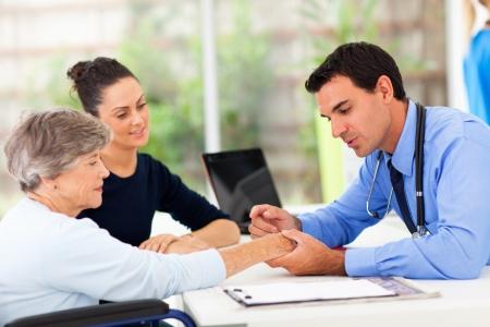 dermatologist inspecting senior patient skin in office photo